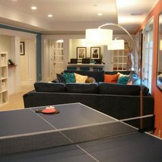 Beautifully Divided: This walk-out basement belongs to a family that has four kids who love to hang out. The long, narrow space is divided into three distinct areas: one for Ping-Pong, one for TV viewing and lounging, and—at the far end of the room—a laptop bar for homework and computer games. Any wonder that the kids like to hang out here?