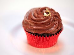 Standing Ovation: Sweet Chocolate Port Cupcakes, Port Wine Reduction Syrup, Raspberry Creme Fraiche Filling, French Chocolate Mousse Recipe : Food Network - FoodNetwork.com