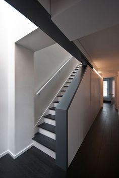 Long staircase spans converted London apartment by PATALAB Architecture dezeen