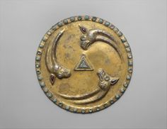 Roundel with griffin heads Date: ca. 1st–2nd century Geography: Eurasian steppes Culture: Sarmatian