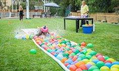 this could be hilarious -- maybe muddy in the desert but whatever. DIY Water Balloon Water Slide