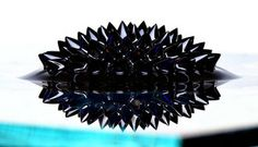 Ferrofluid   Magnetic particles suspended in oil never looked so sexy. That's all a ferrofluid is, and it looks pretty gross until you put it in close proximity to a magnet, at which point it grows spikes all over the place as the fluid flows out along magnetic force lines. $40