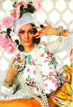 Wilhelmina Cooper in florals and pearls forVogue April 1965. Photoby Irving Penn.