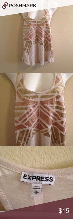 Express Sleeveless Dress Shirt Size Medium. Express Sleeveless Dress Shirt Size Medium. Shimmery printed accents of bronze and copper in the front with back tank with white Print in back. Pre-owned. Good Condition. Express Tops Tank Tops