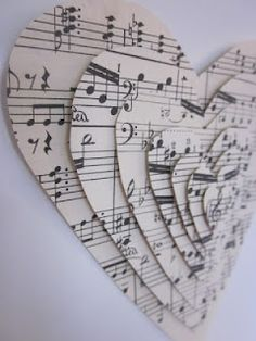 3D hearts made with hand cut sheet music and thick double-sided mounting tape