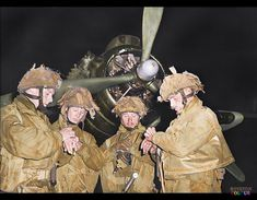 RAF Harwell during the night of 5/6 June 1944, and shows pathfinders of 22nd Independent Parachute Company synchronising their watches. From left to right: Lieutenants De La Tour, Wells, Vischer and Midwood.