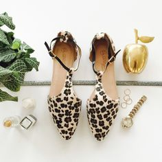 """Leopard Print Ankle T-Strap Faux Calf Hair Flats Leopard Ankle T-Strap Flats   Ankle Strap Cheetah Print Flats in Ivory, Black + Brown  T strap flats Adjustable ankle strap Pointed toe Cushioned insole Flat 1/4"""" heel  Faux (vegan) leather Faux (vegan) calf hair  * New in box * Fits true to size Shoes Flats & Loafers"""