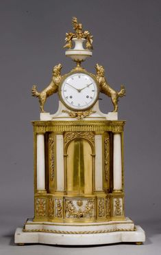 """c1820-40 MANTEL CLOCK """"LA FONTAINE"""" WITH AUTOMATON,Restauration, Paris circa 1820/40. White marble, gilt bronze and brass. Clock case in the form of a fountain with a lion's head and moving glass water jets inside a niche with moving doors  Sold for CHF 10 000 (hammer price) Antique Pendulum Wall Clock, Antique Wall Clocks, Vintage Clocks, Classic Clocks, Retro Clock, Clocks For Sale, Wall Clock Online, Mantel Clocks, Old Wall"""