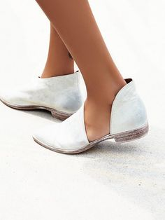 Open sided flat ankle bootie.
