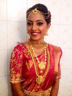 Traditional Southern Indian bride, Divya wears bridal silk saree and jewellery for her Muhuratam. Makeup and hairstyle by Swank Studio. Red lips. Bridal jewelry. Jhumkis. Maang tikka. Bridal hair. Silk sari. Bridal Saree Blouse Design. Indian Bridal Makeup. Indian Bride. Gold Jewellery. Statement Blouse. Tamil bride. Telugu bride. Kannada bride. Hindu bride. Malayalee bride. Find us at https://www.facebook.com/SwankStudioBangalore