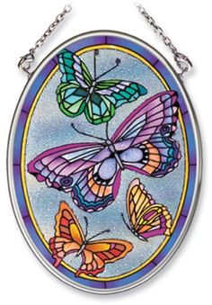 Amia Hand Painted Glass Suncatcher with Butterfly Design, Beaded Background, 3-1/4-Inch by 4-1/4-Inch Oval by Amia. $11.00. Comes boxed, makes for a great gift. Includes chain. Handpainted glass. Amia glass is a top selling line of handpainted glass decor. Known for tying in rich colors and excellent designs, Amia has a full line of handpainted glass pieces to satisfy your decor needs. Items in the line range from suncatchers, window decor panels, vases, votives a...