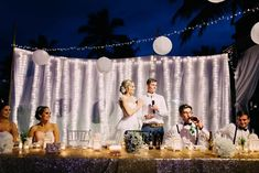Beautiful white and golden themed Fiji wedding reception set up decorations decor warm white fairy lights at the Hilton. Done by 'Fiji Weddings'. Reception speeches. ©Nadi Bay Photography (Fiji) by Laurence Beddoes.