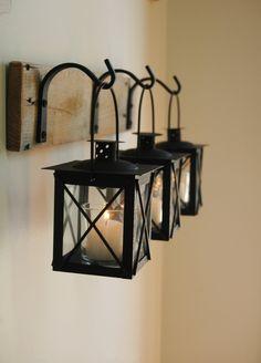 Black Lantern Trio hanging from wrought iron