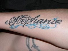 This is probably my favourite of the tattoos of names, I love the light blue in it. Name Tattoos For Girls, Name Tattoos On Arm, Tattoos Arm Mann, Tattoos With Kids Names, Elbow Tattoos, Arm Tattoos For Guys, Arm Band Tattoo, Cool Tattoos, Tattoo Names