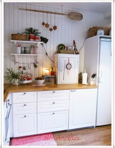 old world charm, love the hanging cookie details, the cookies in box, adorned shelves, greenery.