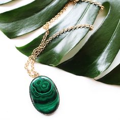 Oval Malachite Pendant with a gold chain. Margaret Elizabeth
