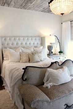Parade of Homes Inspiration-love the couch at the foot of the bed