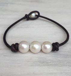 A personal favorite from my Etsy shop https://www.etsy.com/listing/256434554/brown-leather-freshwater-pearl-bracelet