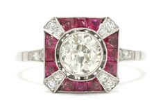 The Carpinteria vintage engagement ring. Channel your inner Zelda with this Art Deco Gatsby-Era inspired stunner. Beaming proudly from the center of this sun-ray design is the juciest, chunky-faceted antique cut old European diamond of a substantial, full 1 Carat that sparkles even under candlelight, lined by rubies. #xring #x #ruby #rubies #diamond #diamonds #engagementring #engagementrings #1carat #onecarat #artdeco #artdecoring #artdecorings #bridalring #bridalrings #oldeuropean #platinum Estate Engagement Ring, Antique Engagement Rings, Antique Rings, Diamond Engagement Rings, 1 Carat, Art Deco Ring, Diamond Settings, Cut, Bridal Rings