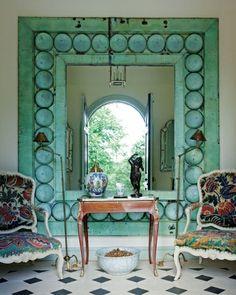 An antique mirror makes a dramatic entrance.