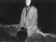 This previously unseen photograph, thought to be taken on Saddleworth Moor, near Manchester, shows Myra Hindley, then aged about 23, sitting on a stone wall at night wearing a pair of shiny black gloves