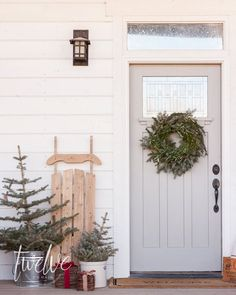 Fresh blue spruce trees, simple natural farmhouse Christmas decor, DIY live wreath, and a vintage wooden sled!