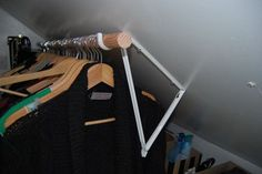 If you've got a slanted ceiling or roof line, shelves can be tough. Add a rod instead. This especially handy for puffy winter jackets that seem to take up half of the coat closet. See more at Apartment Therapy *neat door for coats Attic Closet, Attic Playroom, Closet Rod, Attic Rooms, Attic Spaces, Closet Space, Attic Office, Garage Attic, Small Attic Bedrooms