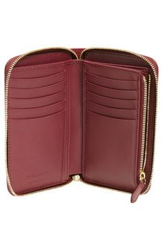 Free shipping and returns on Burberry 'Marston - Horseferry Check' Zip Around Wallet at Nordstrom.com. Grained leather in a rich plum hue beautifully complements Burberry's Horseferry check on this luxe zip-around wallet. With its multitude of card slots and currency pockets, you'll have your essentials stylishly organized in no time.