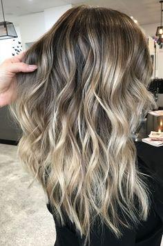 Balayage face framing blonde Textured curls