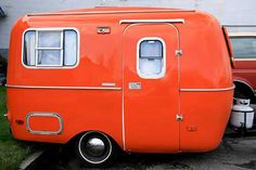 wonderful orange mini camper! could be fun for kids to roll around the country in the summer...
