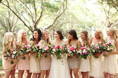 bridesmaids chose their own neutral dresses and carried  loose unstructured bouquets of coral charm peony, red ranunculus, Vendala roses, hot pink ranunculus, light pink lisianthus, jasmine vine, magnolia leaves, lemon leaf, peach stock, succulents & seeded eucalyptus wrapped in cream muslin ribbon.
