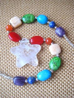 Handmade chunky #rainbow gemstone & #crystal #star necklace. #Chakra statement jewelry. #Colorful #Hippie Boho love beads. Turquoise, amethyst, quartz, carnelian, italian onyx, jasper and lapis by WildThingsAdornments on #etsy #chaoscurators