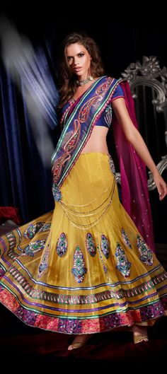 #bright #color can make you look fab. Specially in Voluminous #Lehengacholi. Wear the old tradition of free flowing lehenga which always stays in trend.  Code:66206
