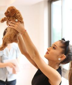 Ariana Grande holding up puppy instead of a baby lion.