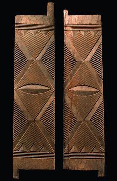 Africa | Two door wings from the Igbo people of Nigeria | Wood; matt brown patina