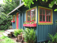 Bright little cabin with board and batten exterior, window boxes are a nice touch WINDOW BOXES Cottage Exterior, House Paint Exterior, Exterior Paint Colors, Exterior House Colors, Exterior Design, Painted Shed, Board And Batten Exterior, Shed Colours, Little Houses