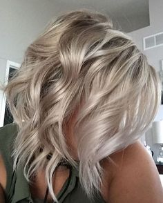 ICE • equal parts Wella Instamatics smokey amethyst + 10/6 1.9% for 20 minutes on damp hair. Follow up with Matrix So Silver shampoo. Curl with BabylissPro 1 1/4 inch curling iron, leaving a tail out on each section to give it a tousled look #hairbykatelyn