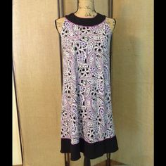 Forever dress Dress by Forever size small. It is purple, white and black floral pattern. It is black at the top and at the bottom. 2 buttons at the top in back. Just above knee length. Good condition. Forever Dresses