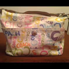 Authentic Coach Watercolor Bag Bright and colorful Coach Watercolor bag. Perfect bag for sunny and warm summer days. Fabric with fabric and leather strap. Ships with satin dust bag to protect your bag when not in use. Gently used. Coach Bags Shoulder Bags