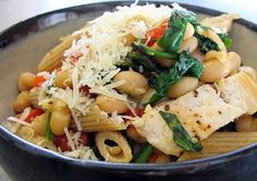 Tuscan chicken pasta with fresh spinach, roasted red peppers, and cannellini beans -- use cooked chicken to cut time