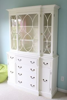 If this were cherry or teak instead of white and had simple handles or knobs, I'd really like it.