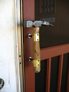 Hammer door pull...I've seen this as entrances to local hardware stores as well.