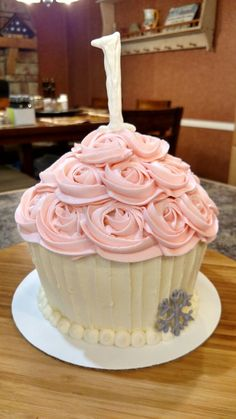 Giant pink cupcake with snowflake for baby's first birthday smash cake...