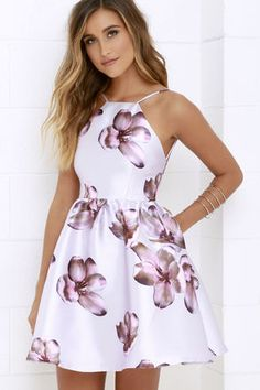 Like the sparkling night sky, the Floral Borealis Lavender Floral Print Dress will be a stunning site to see! Silky lavender woven fabric with a purple, pink, and brown floral print swings from thin straps to an apron neckline, darted bodice, and open back. Full skater skirt takes shape below the fitted waist. Hidden back zipper with clasp.