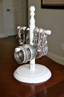 Old wooden coffee cup holder now a jewelry stand.