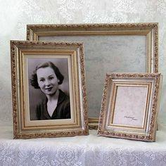Yellow Vintage: vintage style frames display photographs of passed family members. #vintagewedding