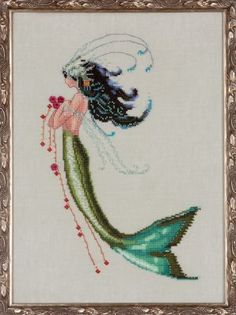 Nora Corbett Mermaid Verde - Cross Stitch Pattern. Model stitched on 32 Ct. Water Lily linen with DMC floss,Kreinik #4 Braid and Mill Hill beads. Stitch Count: