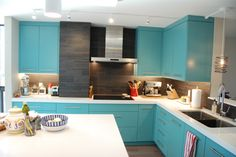 This is a kitchen we just completed in a Condo in Salt Lake City. This client was downsizing from a large Holiday home so they bought two connecting two bedroom units and turned them into a large one bedroom unit complete with a home office and an amazing view of Downtown.  The Cabinets are painted in a Satin Finish to match the color of an inspiration picture my client had. It is a very daring choice but I think it works beautifully in this Condo.
