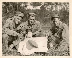 https://flic.kr/p/8qC8BK | Marines On Okinawa With Jap Flag | Three marines showing flag and pet rabbit found on Easter Sunday. Photo taken as fighting continued on the island.