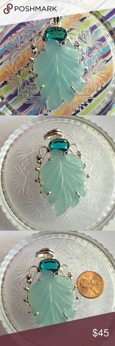 Chalcedony pendant NWOT Sterling silver pendant with a carved leaf blue chalcedony gemstone and a simulated green Quartz stone. Jewelry Necklaces